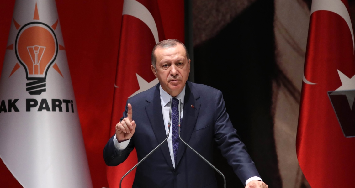 "(FILES) This file photo taken on July 01, 2017 shows Turkish President and ruling Justice and Development (AK) Party chairman Recep Tayyip Erdogan gesturing as he delivers a speech during the AK Party's provincial meeting in Ankara.  Turkish President Recep Tayyip Erdogan on July 25, 2017 urged all Muslims to visit and protect Jerusalem after violence broke out over metal detectors that Israel installed and later removed from a sensitive holy site in the city.""From here I make a call to all Muslims. Anyone who has the opportunity should visit Jerusalem, Al-Aqsa mosque,"" Erdogan said in Ankara, adding: ""Come, let's all protect Jerusalem.""  / AFP PHOTO / ADEM ALTAN"