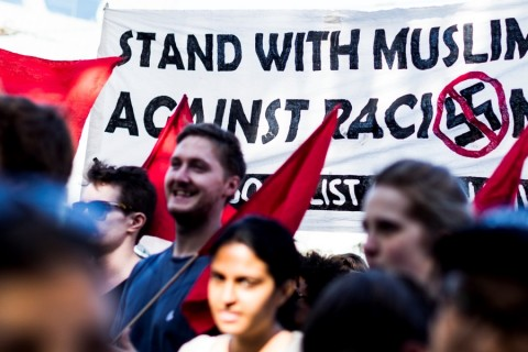 MELBOURNE, AUSTRALIA - APRIL 3 : Protestors march through the CBD outside flinders street station during a protest speaking out against racism and in particular Islamophobia in opposition to the far right groups such as the United Patriots front and Reclaim Australia at the Federation Square, Melbourne, Australia on April 3, 2016. ( Asanka Brendon Ratnayake - Anadolu Agency )