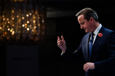 British Prime Minister David Cameron addresses delegates at the annual Confederation of British Industry (CBI) conference in central London, on November 9, 2015. Britain can survive outside the European Union, Cameron said as he denied he was planning to campaign for Britain to stay in the EU regardless of the outcome of reform talks.    AFP PHOTO / LEON NEAL / AFP / LEON NEAL