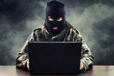 43768362 - masked cyber terrorist in military uniform hacking army intelligence