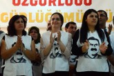 People wearing T-shirts featuring jailed PKK leader Abdullah Ocalan applaud after Turkey's pro-Kurdish People's Democratic Party (HDP) co-chair Sebahat Tuncel speech on September 5, 2016 in Diyarbakir before starting a hunger strike to demand news about the Kurish leader. Several pro-Kurdish parties and activist groups, say they have no news about jailed PKK leader Abdullah Ocalan for more than 500 days and they will continue the strike until they get some news. A voluntary group of people also including MPs from the HDP party will take part in the strike. / AFP PHOTO / ILYAS AKENGIN