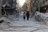 Suriye'de Rusya ve rejime ait savaş uçakları, Halep kent merkezinde Esed güçlerinin kuşatmasındaki Bustan el Kasr semtine hava saldırısı düzenledi. Saldırı sonucu, bölgedeki binalar hasar gördü. ( İbrahim Ebu Leys - Anadolu Ajansı )