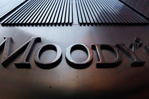 A Moody's sign on the 7 World Trade Center tower is photographed in New York August 2, 2011.   Behind all too many of market moves in government debt of late has been a report from one of the major credit ratings agencies. Standard & Poor's is the biggest and arguably the most influential, fast followed by Moody's Investor Service and then their smaller rival, Fitch Ratings. In national capitals, they are alternately villified by politicians or held out as just arbiters for denouncing government profligacy.   REUTERS/Mike Segar   (UNITED STATES - Tags: BUSINESS POLITICS)