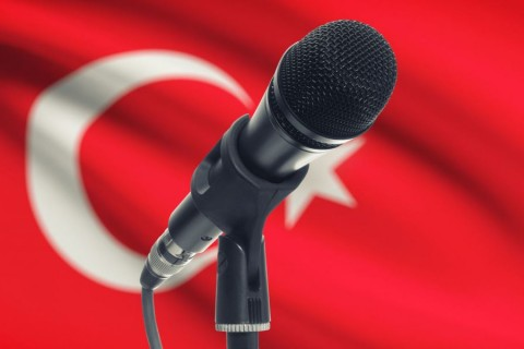 42110940 - microphone with national flag on background series - turkey