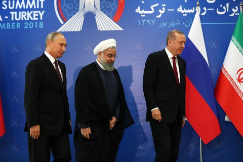 TEHRAN, IRAN - SEPTEMBER 7: President of Turkey Recep Tayyip Erdogan (R), President of Iran Hassan Rouhani (C) and President of Russia Vladimir Putin (L) attend the trilateral summit between Turkey, Iran and Russia on September 7, 2018 in Tehran, Iran.