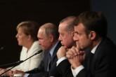 28 Ekim 2018 | Türkiye Cumhurbaşkanı Recep Tayyip Erdoğan'ın (sağ 2) ev sahipliğinde, Rusya Devlet Başkanı Vladimir Putin (sol 2), Fransa Cumhurbaşkanı Emmanuel Macron (sağda), Almanya Başbakanı Angela Merkel'in (solda) katılımıyla gerçekleştirilen Suriye konulu dörtlü zirvenin ardından liderler, basın toplantısı düzenledi.