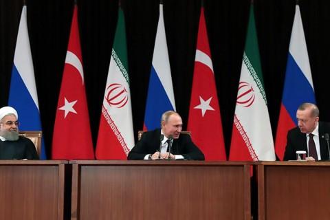 14 Şubat 2019 | Cumhurbaşkanı Recep Tayyip Erdoğan, Rusya Devlet Başkanı Vladimir Putin ve İran Cumhurbaşkanı Hasan Ruhani, Suriye konulu zirvede Rusya'nın Soçi kentinde bir araya geldi.