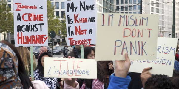 """Demonstrators protest with placards reading """"Islamophobia is a crime against humanity"""" and """"My name is Khan and I am not a terrorist"""" against Islamophobia during a protest march on October 26, 2014 in Brussels. AFP PHOTO / BELGA / NICOLAS MAETERLINCK +++ BELGIUM OUT / AFP / BELGA / NICOLAS MAETERLINCK"""