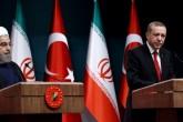 Cumhurbaşkanı Recep Tayyip Erdoğan ve İran Cumhurbaşkanı Hasan Ruhani, ikili görüşmelerin ardından Cumhurbaşkanlığı Külliyesi'nde ortak basın toplantısı düzenledi.  ( Cumhurbaşkanlığı / Yasin Bülbül - Anadolu Ajansı )
