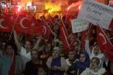 """Fetullahçı Terör Örgütünün (FETÖ) darbe girişimi, Van'da protesto edildi. Beşyol Meydanı'nda demokrasi nöbetine devam eden binlerce vatandaş, ellerinde bayraklarla """"Şehitler ölmez, vatan bölünmez"""", """"Recep Tayyip Erdoğan"""", ''Darbeye hayır"""" ve ''Vanlılar burada darbeciler nerede'' şeklinde slogan attı. ( Cemal Aşan - Anadolu Ajansı )"""