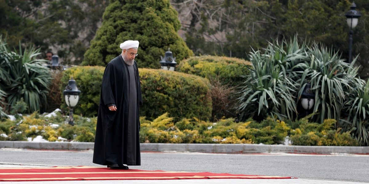 Iran's President Hassan Rouhani waits for the arrival of Indonesia's president at Saad Abad palace in Tehran on December 14, 2016.  / AFP PHOTO / ATTA KENARE