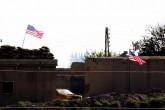 U.S. flags on YPG terrorist headquarters