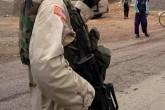 YPG terrorist with American
