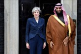 Britain's Prime Minister Theresa May greets the Crown Prince of Saudi Arabia Mohammad bin Salman outside