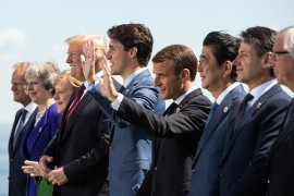 (L-R) The President of the European Council Donald Tusk, British Prime Minister Theresa May, German Chancellor Angela Merkel, US President Donald Trump, Canadian Prime Minister Justin Trudeau, French President Emmanuel Macron, Japanese Prime Minister Shinzo Abe, Italian Prime Minister Giuseppe Conte, and the President of the European Commission Jean-Claude Juncker pose for a family photo during the G7 Summit in La Malbaie, Quebec, Canada 08 June 2018.