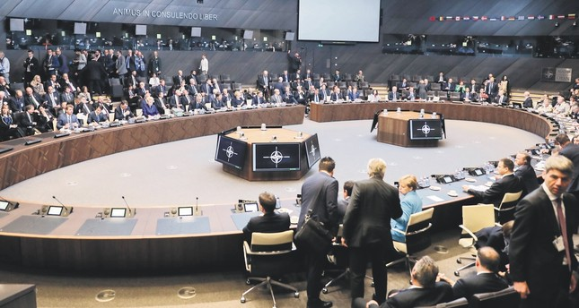 Heads of state and government with their delegations attend a working session during the summit at NATO headquarters, Brussels, July 11.