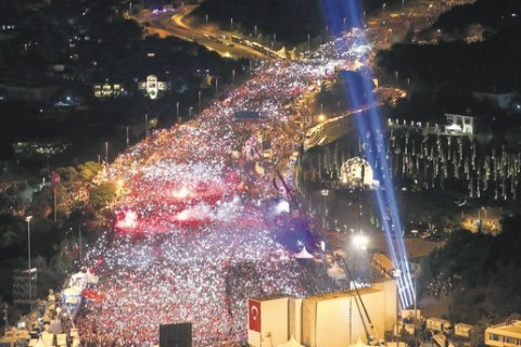 Crowds wave flags during a ceremony commemorating the victims of the July 15 coup attempt, Istanbul, July 15, 2017.