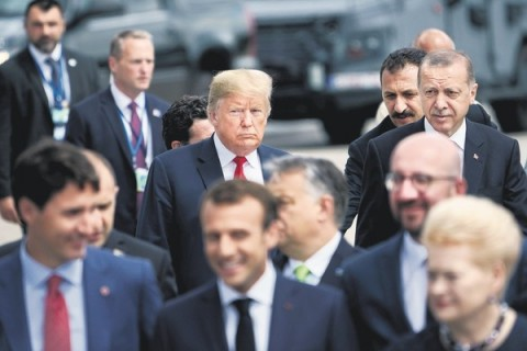"U.S. President Donald Trump (L) and President Recep Tayyip Erdoğan (R) follow other leaders to a ""family photo ""during the summit at NATO headquarters, Brussels, July 11."
