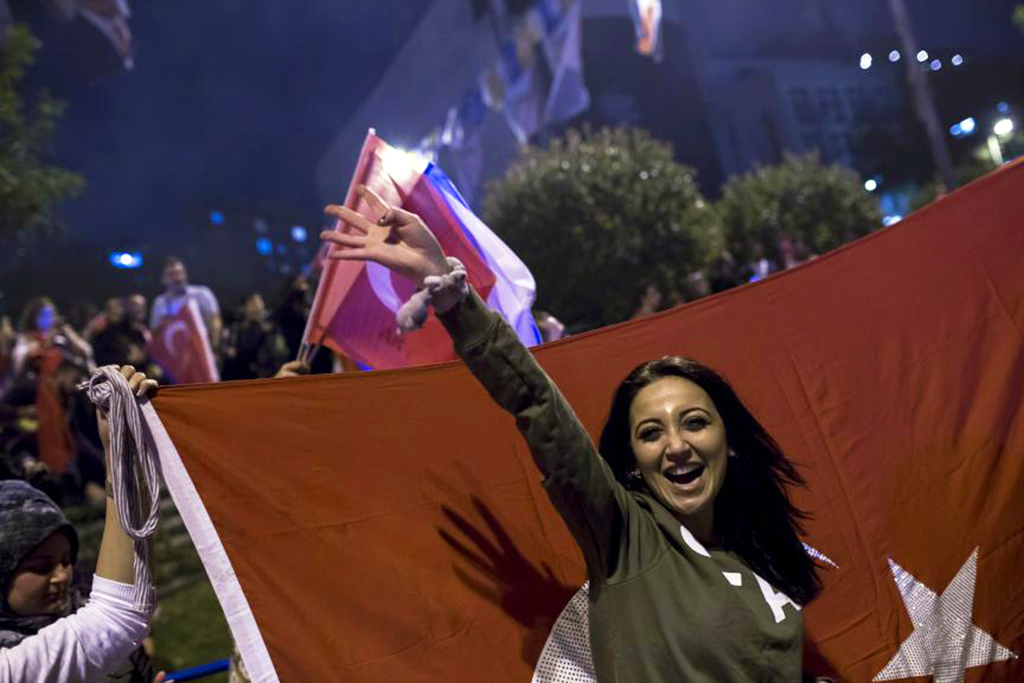 People gather to celebrate the results of the June 24 presidential elections, Samsun, early Monday.