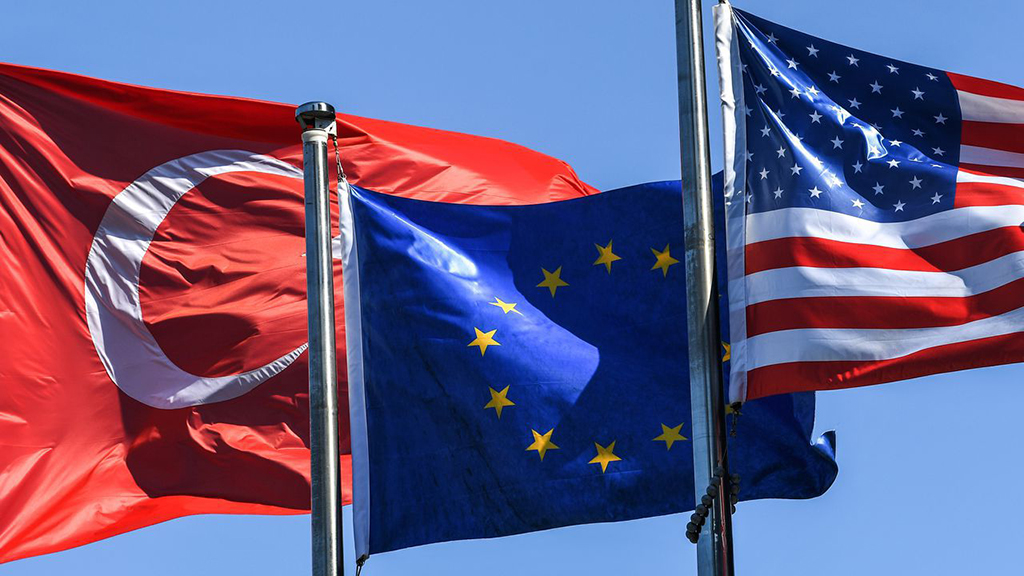 (From L) The Turkish flag, the European Union flag and the U.S. flag float in the wind in the financial and business district of Maslak, Istanbul, Aug. 15.