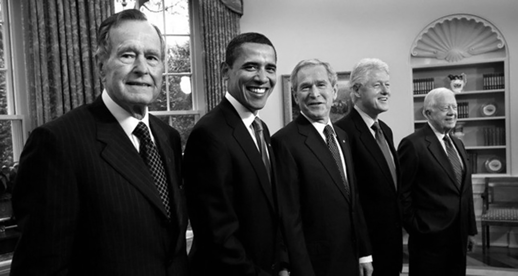 (From left to right) Former U.S. Presidents George H.W. Bush, Barack Obama, George W. Bush, Bill Clinton and Jimmy Carter in the Oval Office at the White House, Jan. 7, 2009.