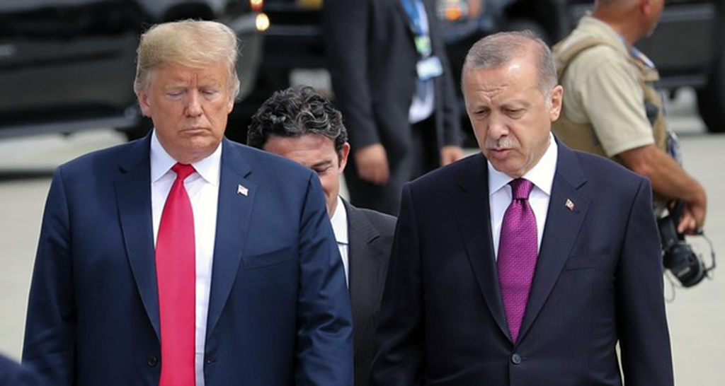 U.S. President Trump (L) and President Erdoğan (R) talk while walking to attend the NATO Brussels Summit, Belgium, July 11.