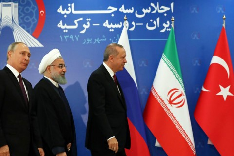 President Recep Tayyip Erdoğan (R), Iranian President Hassan Rouhani (C) and Russian President Vladimir Putin (L) prepare to leave the stage during the trilateral summit on the Idlib crisis, Tehran, Sept. 7.