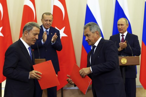 SOCHI, RUSSIA - SEPTEMBER 17 : Turkey's National Defense Minister Hulusi Akar (L) and Defense Minister of Russia, Sergey Shoygu (2nd R) hold documents after signing a memorandum of understanding following a joint press conference held by Turkish President Recep Tayyip Erdogan (Rear L) and Russian President Vladimir Putin (Rear R) in Sochi, Russia on September 17, 2018.