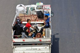 Residents of Idlib province flee toward the Syrian-Turkish border amid ongoing attacks by Russia and regime forces, Sept. 10.