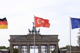 Turkish, German and EU flags wave near the Brandenburg Gate in Berlin, one day before President Recep Tayyip Erdoğan arrives to the German capital to meet with German President Frank-Walter Steinmeier and German Chancellor Angela Merkel.