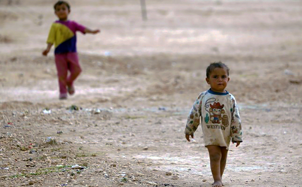 Displaced Syrian children from Deir Ezzor walk near a camp for displaced people in the province of Hasakeh, Oct. 8.