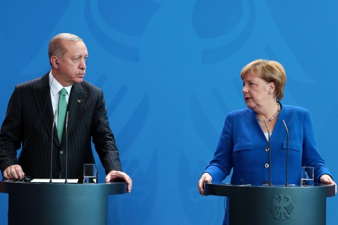 President Erdoğan (L) and German Chancellor Angela Merkel (2-L) walk to a meeting on the future of bilateral ties at the Chancellery, Berlin, Sept. 29.