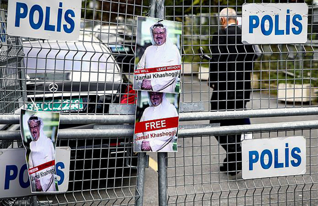 Photos of missing Saudi journalist Jamal Khashoggi hang on a police fence during a demonstration in front of the Saudi Arabian consulate, Istanbul, Oct. 8.