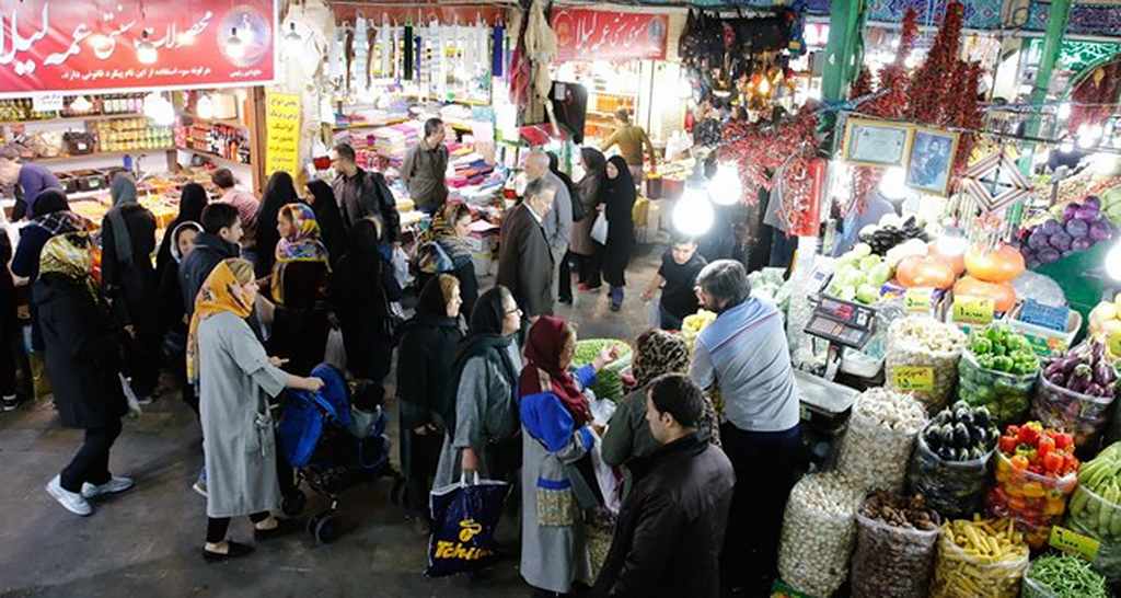Iranians shop in a bazaar in Tehran, Nov. 5.