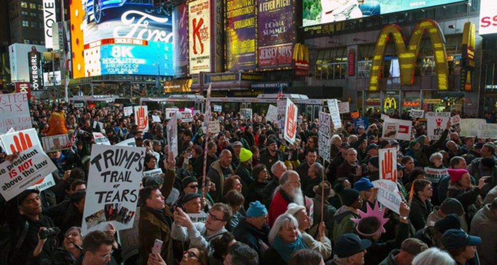 People attend a protest in Times Square the day after President Donald Trump forced the resignation of Attorney General Jeff Sessions, New York City, Nov. 8.