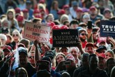 Supporters await the arrival of President Donald Trump at a rally for the upcoming midterm elections, at the Southern Illinois Airport, Murphysboro, Illinois, Oct. 27.