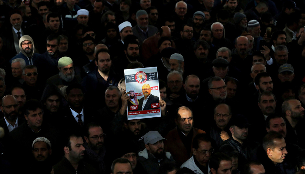 People attend a symbolic funeral prayer for Saudi journalist Jamal Khashoggi in the courtyard of Fatih Mosque in Istanbul, Nov. 16.