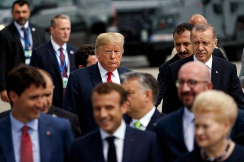 President Recep Tayyip Erdoğan (R) and U.S. President Donald Trump (L) follow other leaders for a photo shoot during the NATO summit in Brussels, July 11.