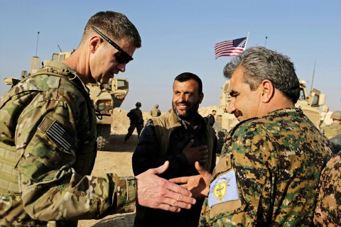 U.S. General Jamie Jarrard (L) thanks a YPG commander near the town of Manbij, northern Syria, Feb. 7, 2018.
