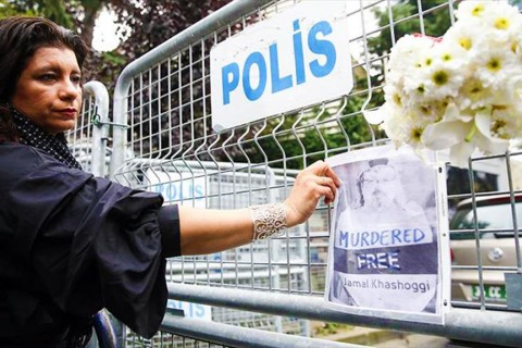 "Sahar Zaky, a Egyptian-origin Canadian activist protested the murder of Washington Post columnist Jamal Khashoggi. Zaky places flowers and holding a placard reading ""murdered here"" stood outside the Saudi Consulate in Istanbul where the journalist was last seen on Oct. 2."