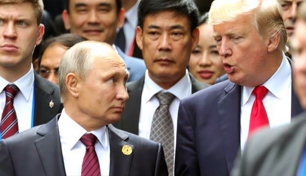 Russian President Vladimir Putin, left, and US President Donald Trump,right, during the Asia-Pacific Economic Cooperation (APEC) Summit in Danang, Vietnam, November 11, 2017.