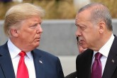 U.S. President Donald Trump (L) and President Recep Tayyip Erdoğan gesture as they talk at the start of the NATO summit in Brussels, Belgium, July 11.