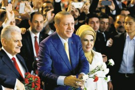 President Recep Tayyip Erdoğan (C), accompanied by his wife Emine Erdoğan, and the then-Prime Minister Binali Yıldırım, now the AK Party's Istanbul mayoral candidate, greet members and supporters during a party congress, Ankara, May 21, 2017.