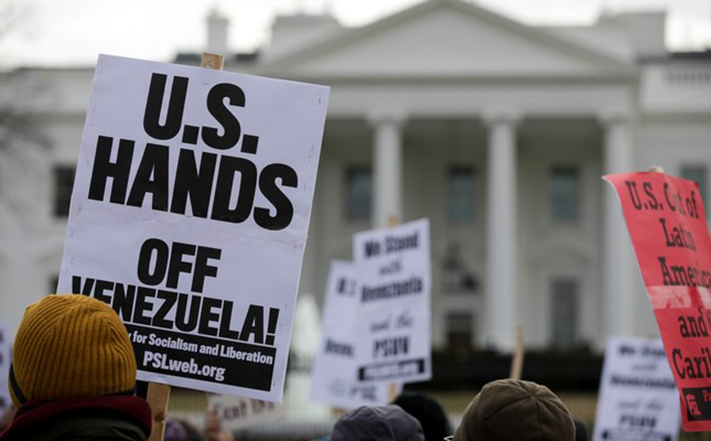 People attend a demonstration against the U.S.'s involvement in the coup attempt against Venezuela's elected President Nicolas Maduro, in front of the White House, Jan. 27, 2019.