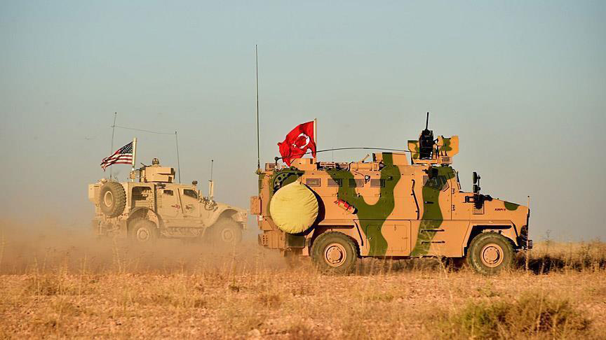 Turkish and U.S. troops participate in a joint patrol around Manbij, northern Syria, Nov. 1, 2018.