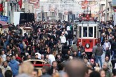 People walk through Istanbul's crowded iconic streets on İstiklal Avenue, Taksim.