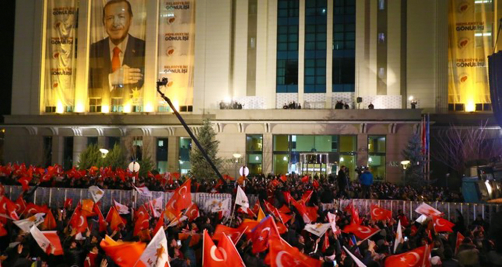 AK Party supporters wave flags after the results of the local elections in front of the AK Party headquarters in the capital Ankara, April 1, 2019.