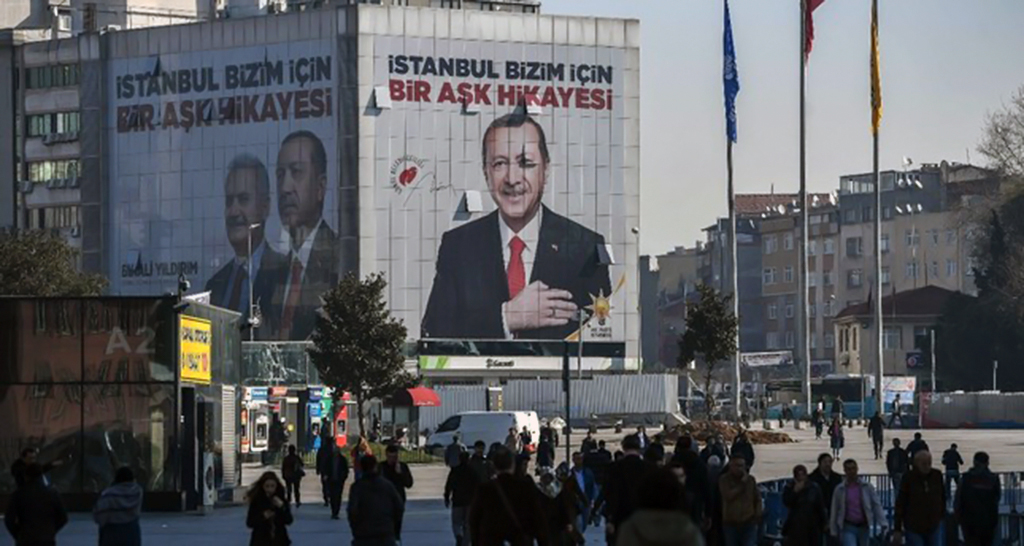 "A giant campaign poster for local elections bearing a picture of President Erdoğan and reading ""Istanbul Is a Love Story For Us"" covers the facade of a building, March 26, 2019."