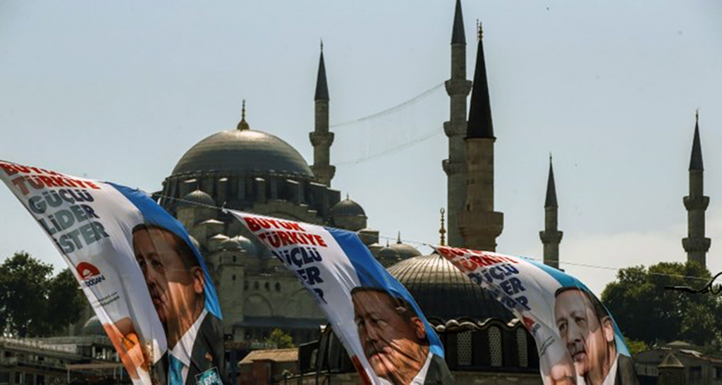 Election posters of President Recep Tayyip Erdoğan, also the chairman of the Justice and Development Party (AK Party), decorate a street in Istanbul, June 6, 2018.