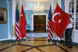 A U.S. State Department staffer adjusts a Turkish flag before a meeting between Foreign Minister Mevlüt Çavuşoğlu and U.S. Secretary of State Mike Pompeo at the State Department in Washington, D.C., April 3, 2019.